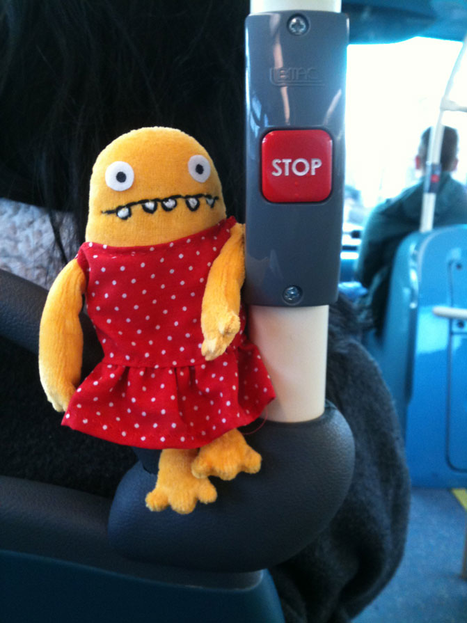 Monster in dress on public transport