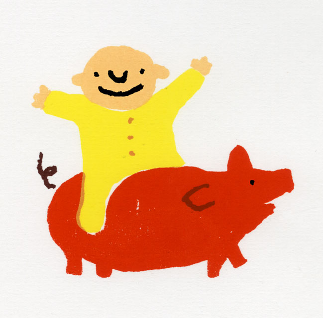 Baby riding pig