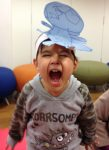 The boy with the T-rex on his head