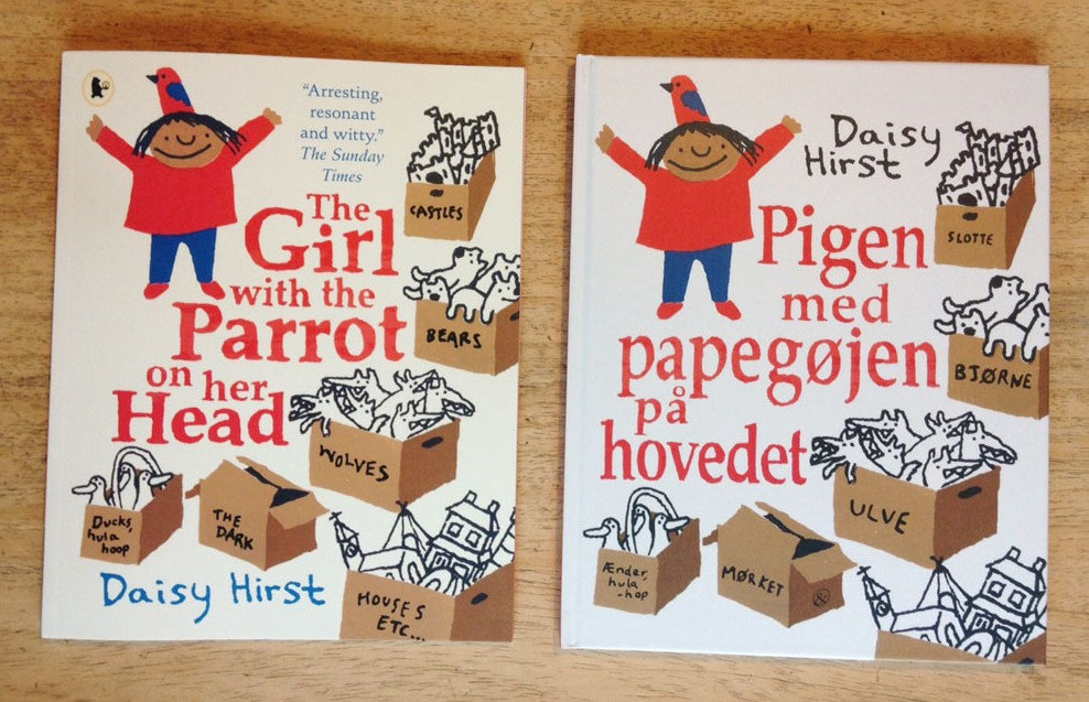 Paperback and Danish edition of The Girl with the Parrot on her Head