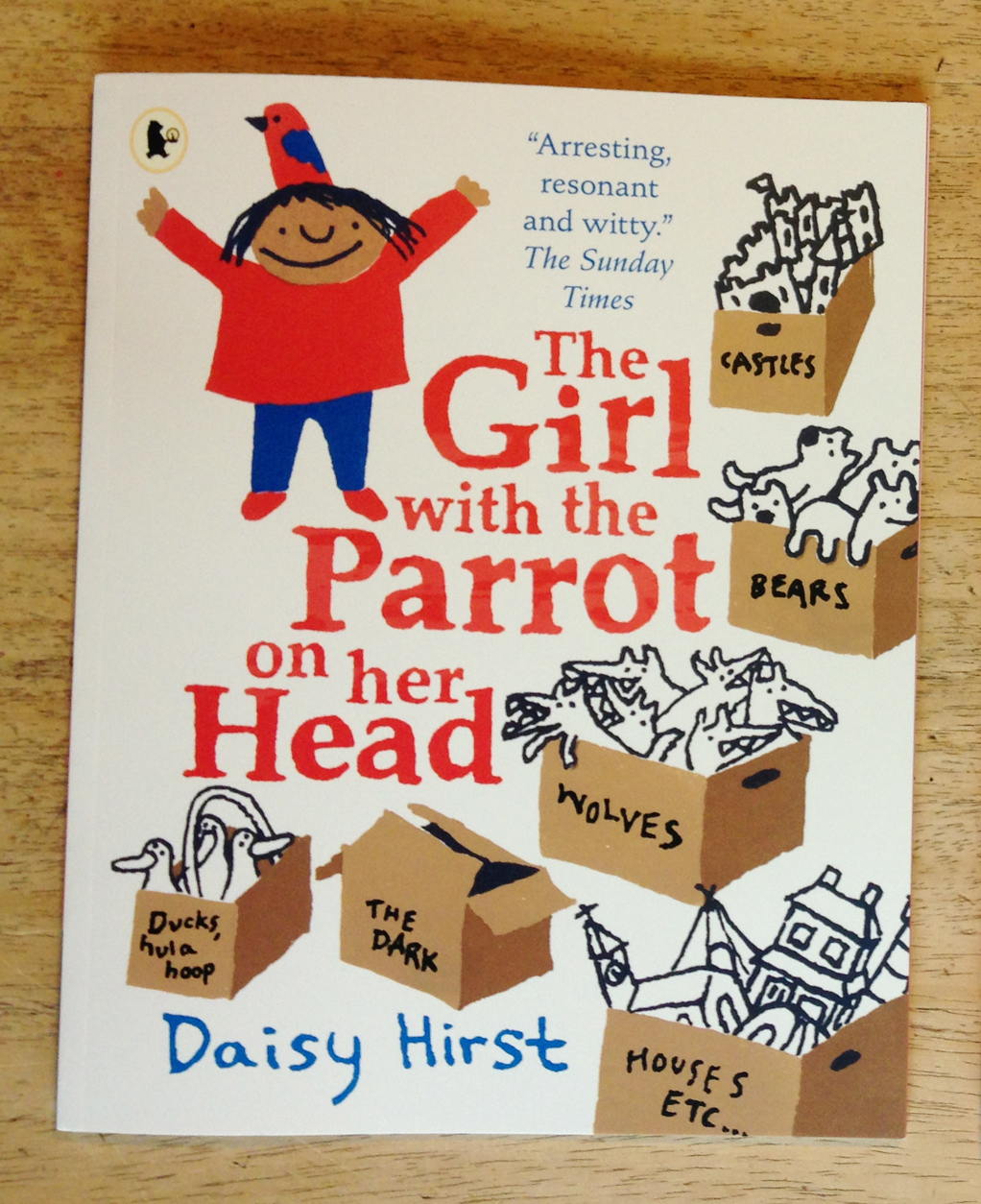 Paperback edition of The Girl with the Parrot on her Head