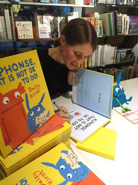 Daisy signing books at ALPHONSE launch