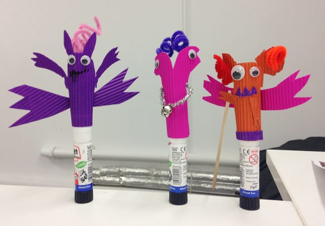 Monster puppets on plinths